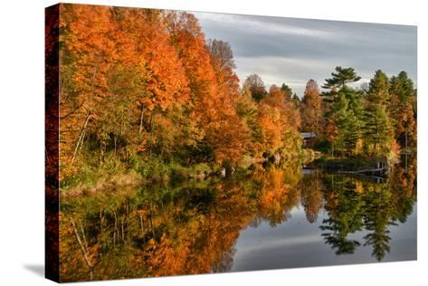 USA, Vermont, Morrisville. Lake Lamoille Reflecting Fall Foliage-Bill Bachmann-Stretched Canvas Print