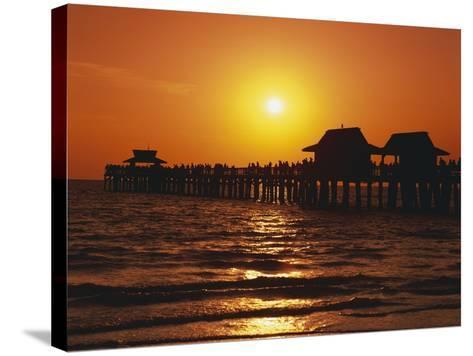 Sun Setting Above Naples Pier-James Randklev-Stretched Canvas Print