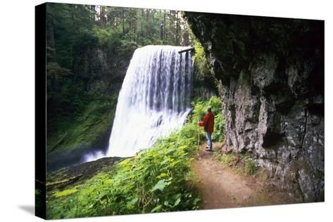 Hiker Looking at Waterfall-Craig Tuttle-Stretched Canvas Print