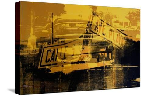 Yellow Car and Street Sign-David Studwell-Stretched Canvas Print