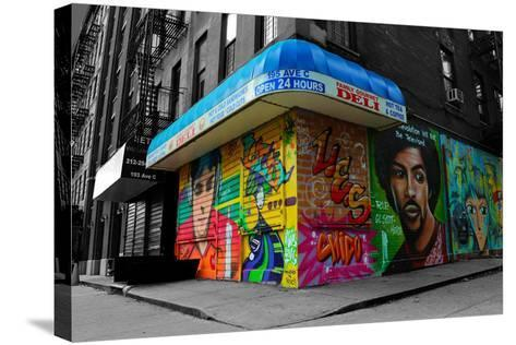 Graffiti on storefronts in NYC--Stretched Canvas Print