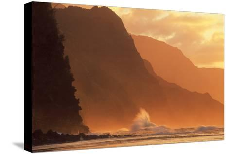 Crashing Waves Against a Mountain at Sunset--Stretched Canvas Print