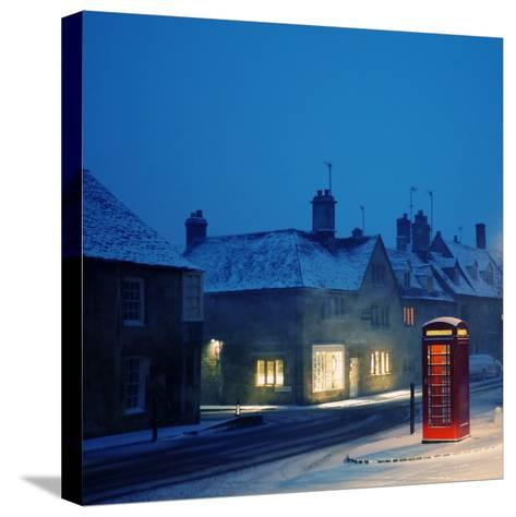 English Red Telephone Booth, in Snow-Andrew Lockie-Stretched Canvas Print
