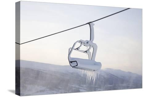 Chair Lift Full of Snow and Ice-Tiina & Geir-Stretched Canvas Print