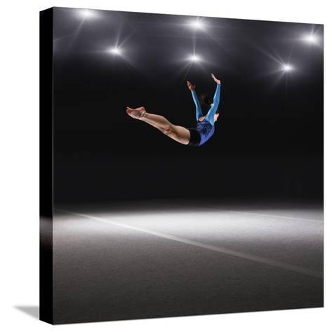 Female Gymnast Jumping through Air-Robert Decelis Ltd-Stretched Canvas Print