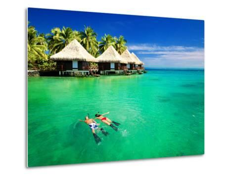 Couple Snorkling in Tropical Lagoon with over Water Bungalows-Martin Valigursky-Metal Print