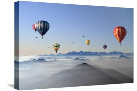 Hot Air Balloons over Mountain Skyline-Axel Lauerer-Stretched Canvas Print