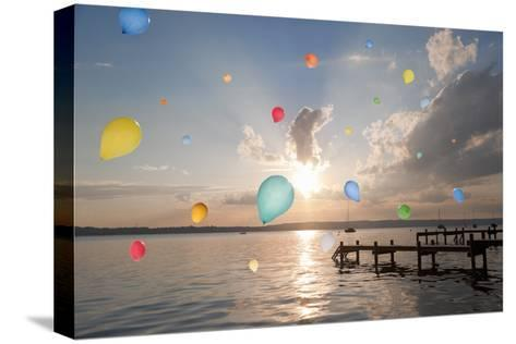 Balloons Floating over Still Lake-Henglein and Steets-Stretched Canvas Print