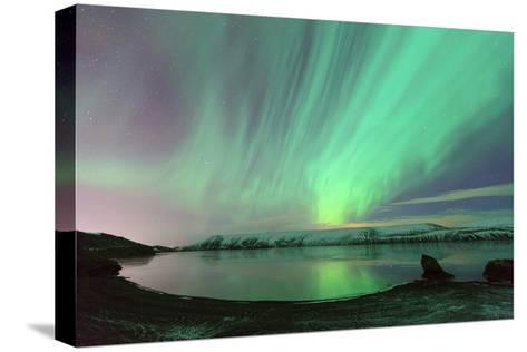 Northern Lights in Iceland-by Chakarin Wattanamongkol-Stretched Canvas Print