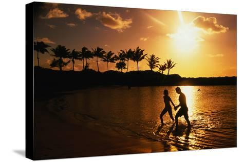 Couple on Beach at Sunset.-Linda Ching-Stretched Canvas Print