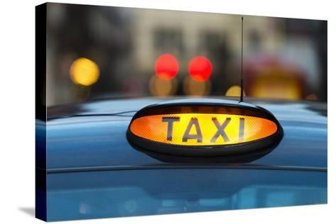 Uk, England, London, Sign on Taxi Cab-Tetra Images-Stretched Canvas Print