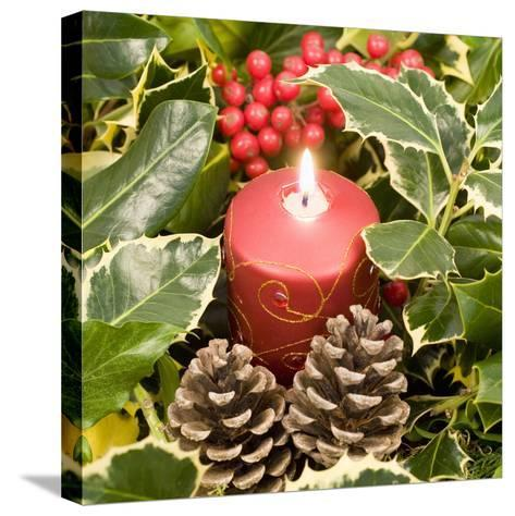 Christmas Candle and Holly Berries--Stretched Canvas Print
