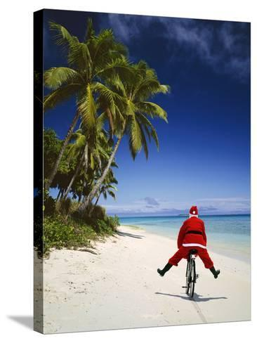 Father Christmas on Bicycle--Stretched Canvas Print