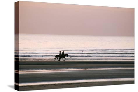 Horse Horseback Riding on Beach by Sunset--Stretched Canvas Print