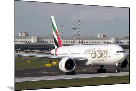 An Emirates Boeing 777 at Milano Malpensa Airport, Italy--Mounted Photographic Print