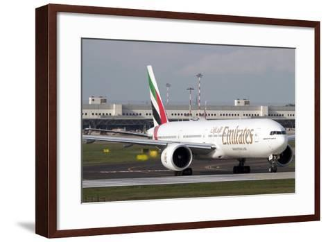 An Emirates Boeing 777 at Milano Malpensa Airport, Italy--Framed Art Print