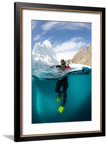 Diver in Front of an Iceberg, Astrolabe Island, Antarctic Peninsula, Antarctica--Framed Art Print