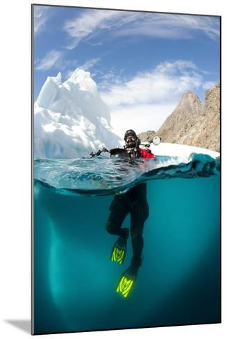 Diver in Front of an Iceberg, Astrolabe Island, Antarctic Peninsula, Antarctica--Mounted Photographic Print