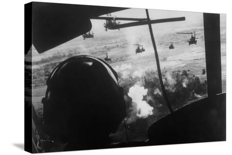 Bell Uh-1 Huey Squadron Firing on Vietcong-Dirck Halstead-Stretched Canvas Print