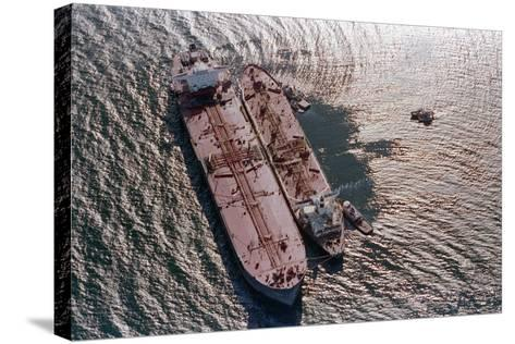 Tanker Pumping Oil from Exxon Valdez--Stretched Canvas Print