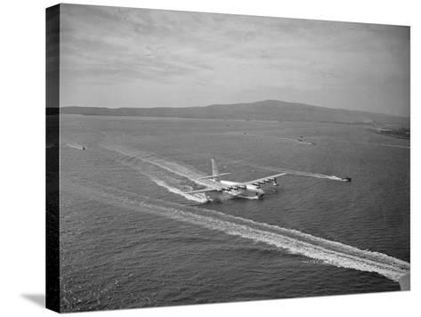 Howard Hughes' Spruce Goose Taxiing across Water--Stretched Canvas Print