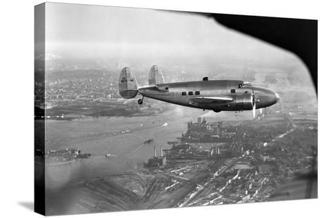 Howard Hughes Lockheed 14 Super Electra over New York City--Stretched Canvas Print