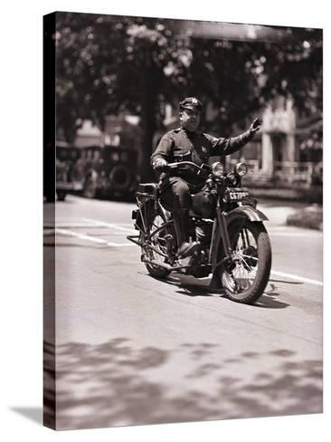 Police Officer on Motorcycle-Philip Gendreau-Stretched Canvas Print