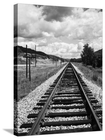 Railroad Tracks Stretching into the Distance-Philip Gendreau-Stretched Canvas Print