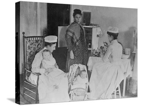 Nurses Caring for Children in Hospital--Stretched Canvas Print