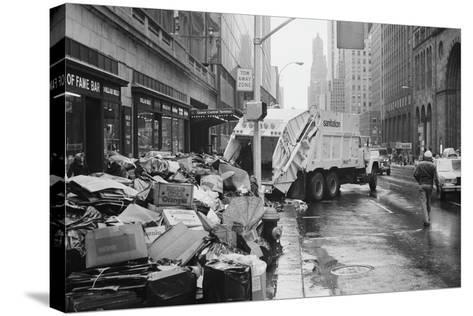 Sanitation Trucks Collecting Garbage--Stretched Canvas Print