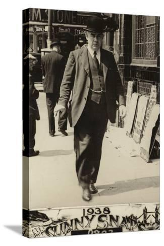 Man in a Bowler Hat Walking Along a Street, 1938--Stretched Canvas Print