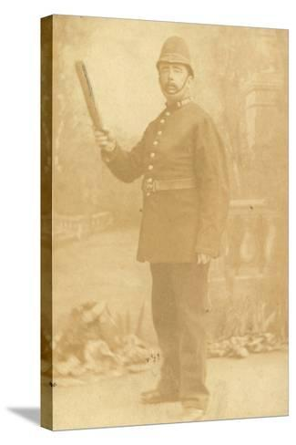 British Policeman Holding His Truncheon--Stretched Canvas Print