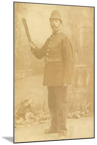 British Policeman Holding His Truncheon--Mounted Photographic Print