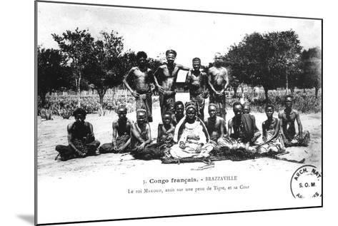 King Makoko, Seated on a Tiger Skin, and His Court, in Brazzaville, French Congo--Mounted Photographic Print