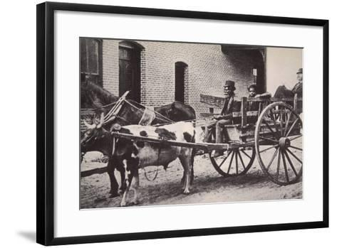 Mark Twain in the Back of a Horse and Ox Drawn Cart, Turn of the Century--Framed Art Print