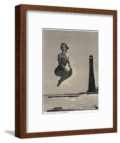 Woman Jumping in Front of Cape Florida Lighthouse, C.1975--Framed Art Print