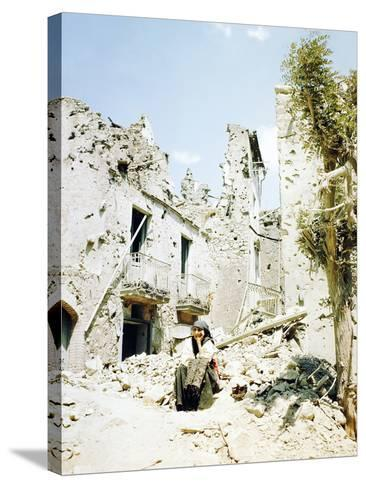 An Old Woman Sits in Front of Her Demolished Home in Castelforte--Stretched Canvas Print