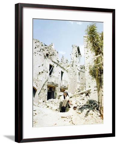 An Old Woman Sits in Front of Her Demolished Home in Castelforte--Framed Art Print