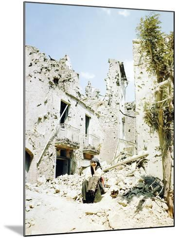 An Old Woman Sits in Front of Her Demolished Home in Castelforte--Mounted Photographic Print