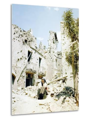 An Old Woman Sits in Front of Her Demolished Home in Castelforte--Metal Print