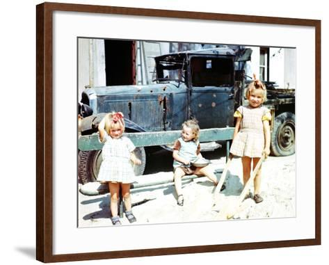 Three Girls Playing in the Sand Next to a War-Damaged Vehicle, Cherbourg, France, July 1944--Framed Art Print
