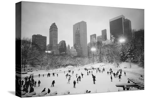 USA, New York, New York City, Skaters at the Wollman Rink-Walter Bibikow-Stretched Canvas Print
