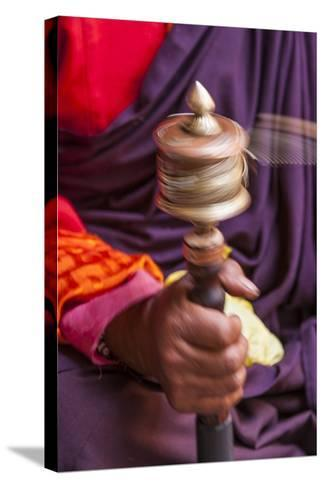 Close Up with a Buddhist and a Hand-Held Prayer Wheel, Bhutan-Gavriel Jecan-Stretched Canvas Print