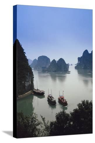 Vietnam, Halong Bay, Tourist Boats Anchor at the Cave of Marvels-Walter Bibikow-Stretched Canvas Print