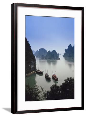 Vietnam, Halong Bay, Tourist Boats Anchor at the Cave of Marvels-Walter Bibikow-Framed Art Print