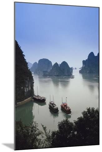 Vietnam, Halong Bay, Tourist Boats Anchor at the Cave of Marvels-Walter Bibikow-Mounted Photographic Print