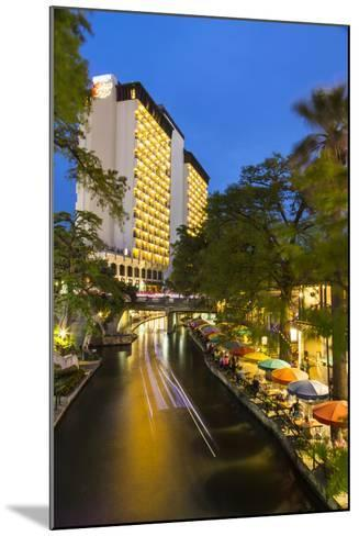 Boat Goes by on the Riverwalk in Downtown San Antonio, Texas, Usa-Chuck Haney-Mounted Photographic Print