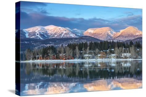 Big Mountain Reflects in Whitefish Lake, Whitefish, Montana, Usa-Chuck Haney-Stretched Canvas Print