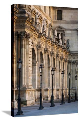 Lampposts Against the Architecture of Musee Du Louvre, Paris, France-Brian Jannsen-Stretched Canvas Print
