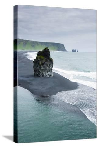 Iceland. Dyrholaey. Black Sand Beach and Sea Stack-Inger Hogstrom-Stretched Canvas Print